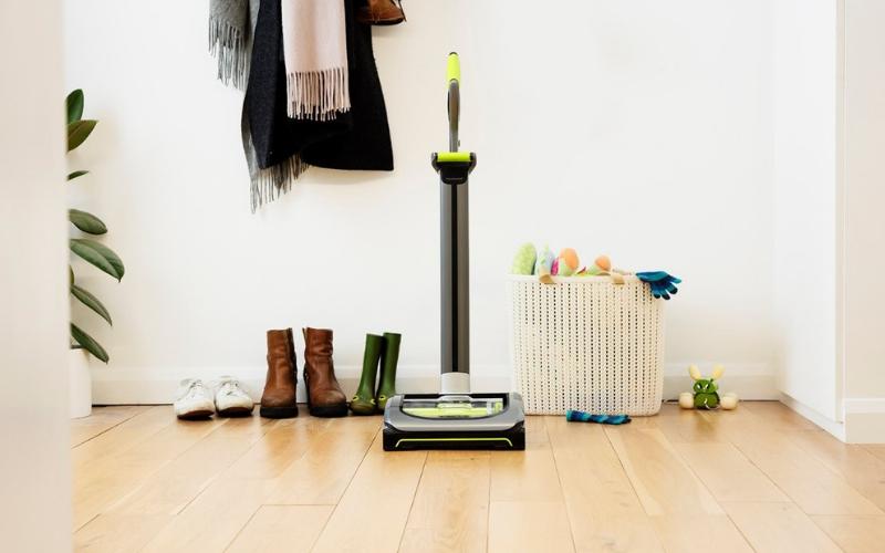 Gtech AirRam cordless vacuum in the hallway