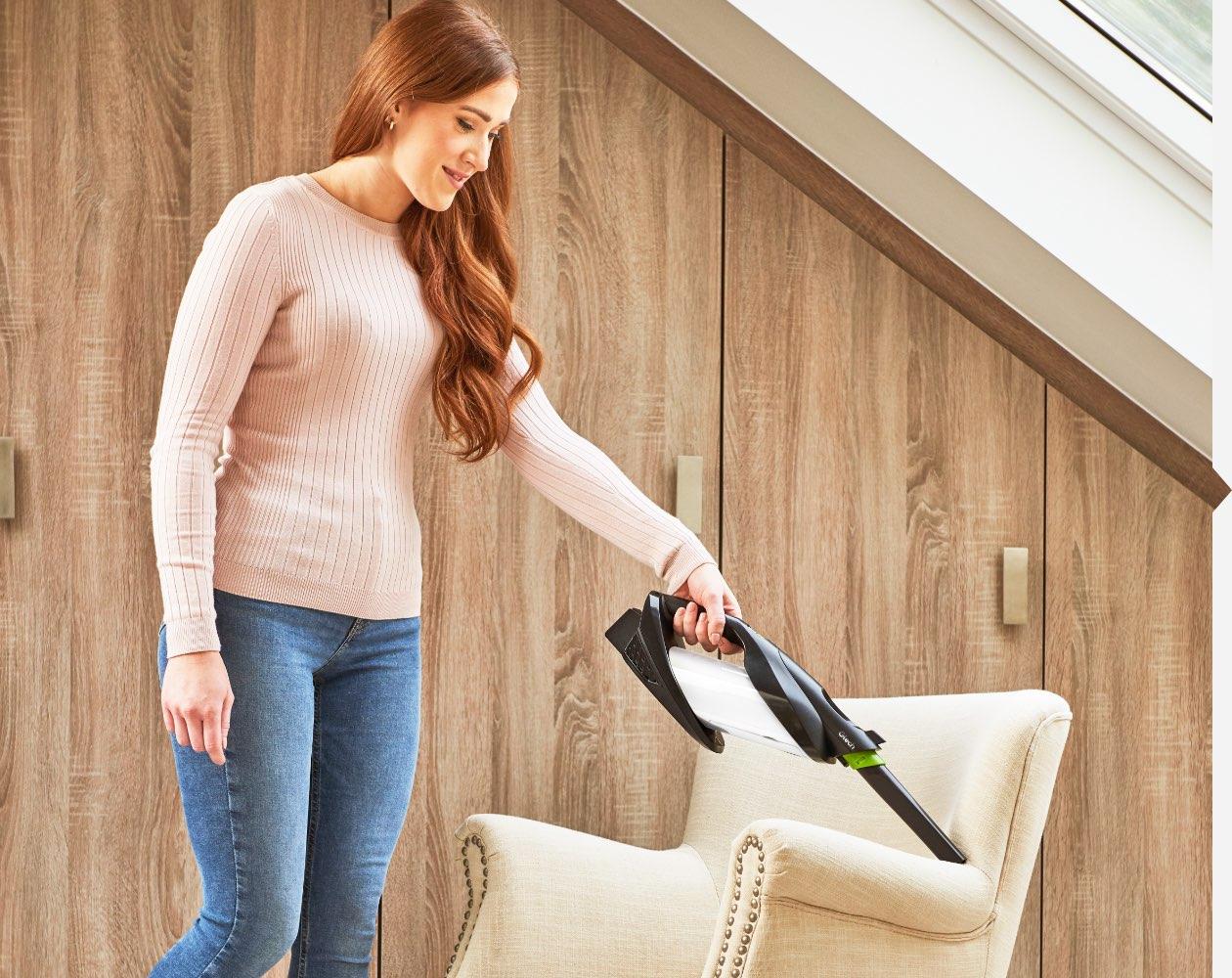 ProLite handheld vacuum crevice tool on upholstery