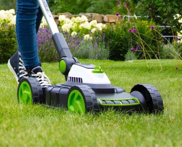 Close up of mini lawnmower cutting grass