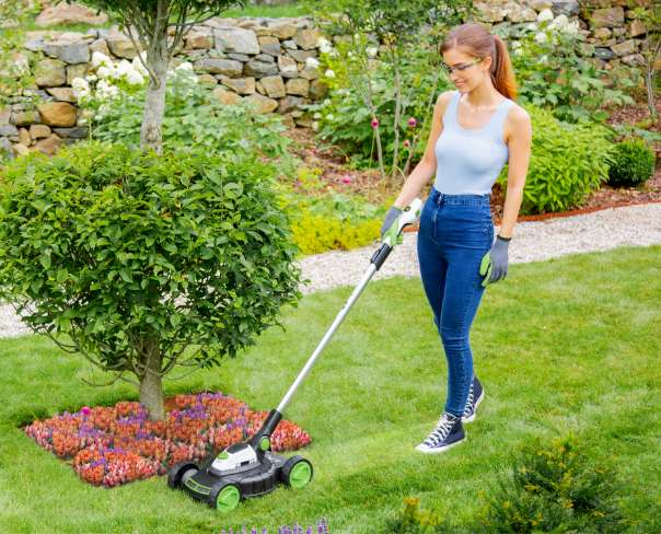 Woman using lightweight lawnmower