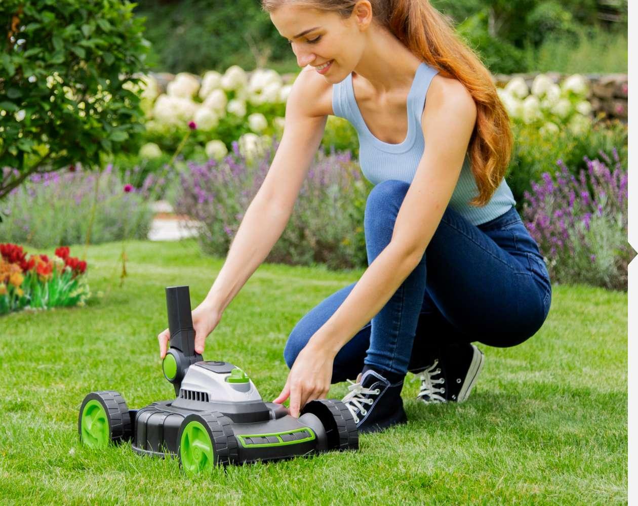 Woman lifting compact lawn mower