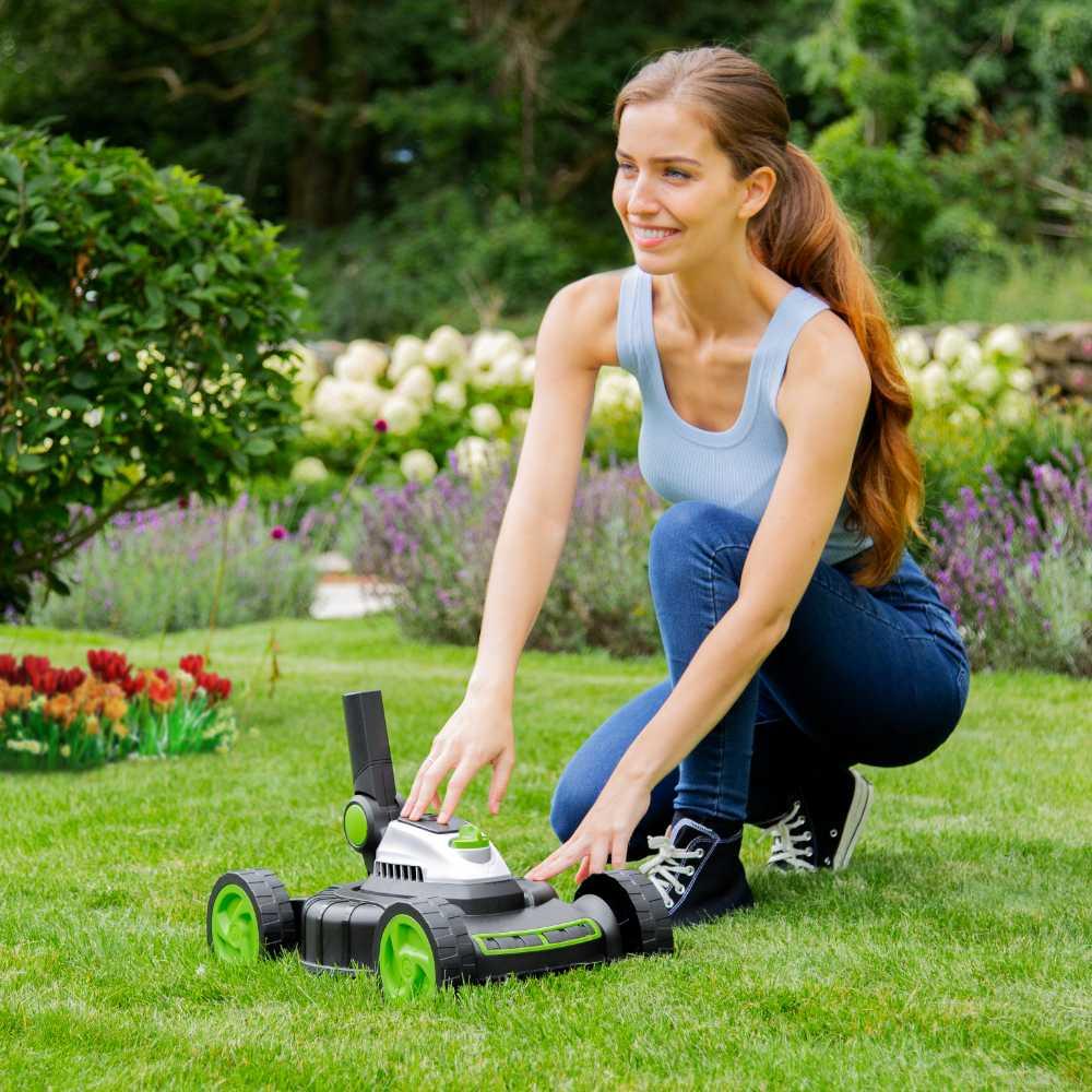 Woman lifting small lawnmower body