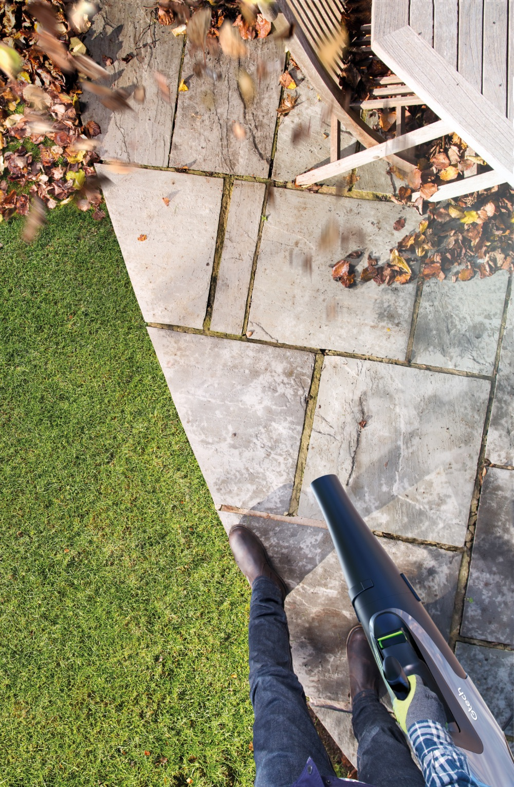 Cordless leafblower blowing away leaves