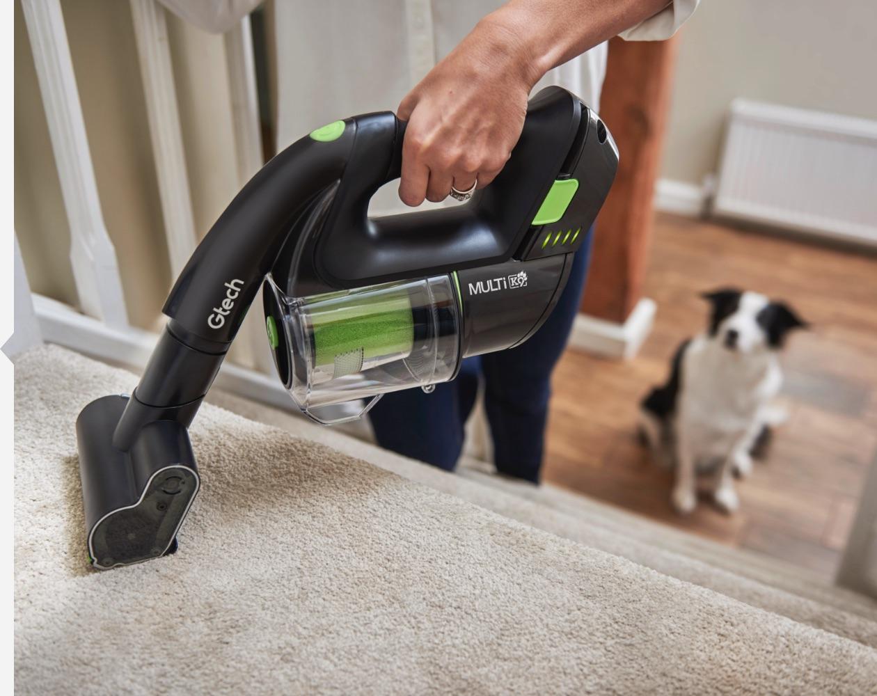 Multi K9 handheld vacuum cleaner used on stairs