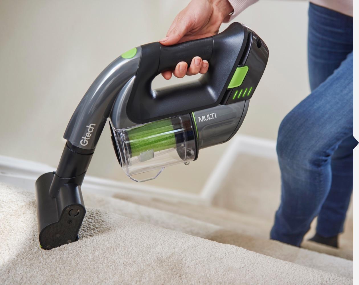 Multi handheld vacuum cleaner used on stairs
